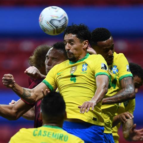 Brazil's Marquinhos jumps for a header during their Conmebol Copa America 2021 football tournament group phase match against Venezuela at the Mane Garrincha Stadium in Brasilia on June 13, 2021. (Photo by EVARISTO SA / AFP)