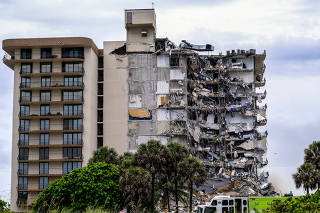 A high-rise residential building is partially collapsed in Surfside, Fla., Thursday, June 24, 2021. (Maria Alejandra Cardona/The New York Times)