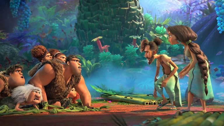 Animação bem colorida onde do lado esquerdo estão quatro famílias pré-históricas e do lado direito dois humanos