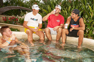 Nelk Boys, from left: Stephen Deleonardis, Jimmy Gambles, Lucas Gasparini and Kyle Forgeard by the hot tub at their home in Encinitas, Calif., June 16, 2021. (Michelle Groskopf/The New York Times)