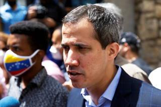 Venezuela's opposition leader Juan Guaido speaks to the media, in Caracas