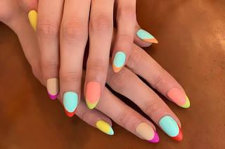 A French mani multicolor design by the nail artist Mei Kawajiri. (via The New York Times)