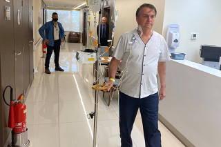 Brazil's President Jair Bolsonaro walks at the Vila Nova Star Hospital in Sao Paulo