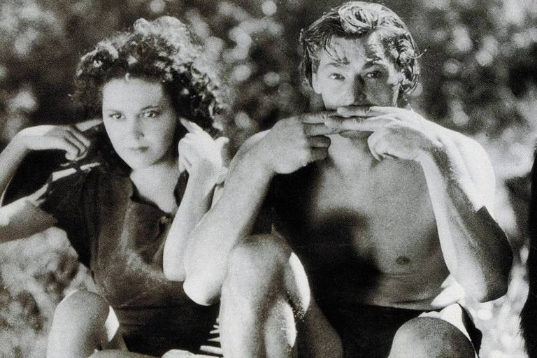 """Maureen O'Sulliva, a Jane, e Johnny Weissmuller em cena do filme """"Tarzan"""""""