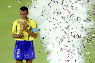 BRAZIL'S CAPTAIN CAFU KISSES THE WORLD CUP TROPHY AFTER HIS TEAM WON THE WORLD CUP FINAL AGAINST GERMANY IN YOKOHAMA