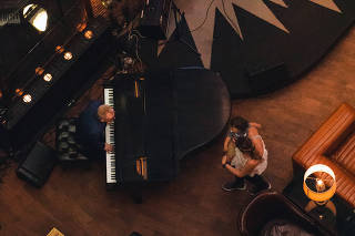 Michael Garin  seen from above performing at the piano at the Roxy Hotel in New York on June 22, 2021. (Justin J Wee/The New York Times)