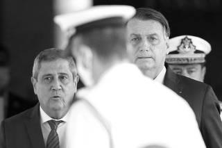 Brazil's President Jair Bolsonaro and Brazil's Defense Minister Walter Souza Braga Netto react after a meeting in Brasilia