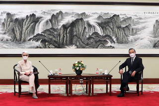 Handout picture of U.S. Deputy Secretary of State Wendy Sherman meeting Chinese State Councilor and Foreign Minister Wang Yi in Tianjin