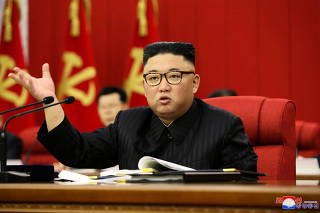 FILE PHOTO: North Korean leader Kim Jong Un speaks during the opening of the 3rd Plenary Meeting of the 8th Central Committee of the Workers' Party of Korea