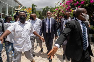 Haitian designated Prime Minister Ariel Henry arrives at a ceremony in the National Pantheon Museum in honor of late Haitian President Jovenel Moise, in Port-au-Prince