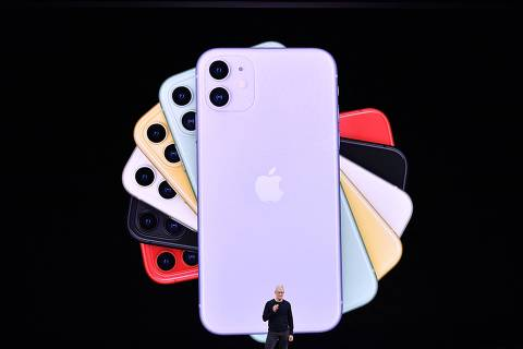 (FILES) In this file photo taken on September 10, 2019 Apple CEO Tim Cook speaks on-stage during a product launch event at Apple's headquarters in Cupertino, California. - Apple's online marketplace would become a