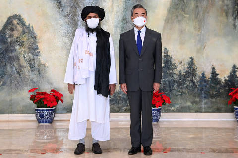 (210728) -- TIANJIN, July 28, 2021 (Xinhua) -- Chinese State Councilor and Foreign Minister Wang Yi meets with Mullah Abdul Ghani Baradar, political chief of Afghanistan's Taliban, in north China's Tianjin, July 28, 2021. (Xinhua/Li Ran)