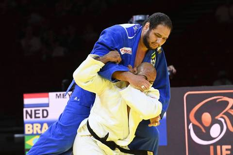 Netherlands' Roy Meyer (white) fights against Brazil's Rafael Silva (blue) in the bronze match of the men's +100kg category during the seventh day of the 2021 Judo World Championships at 'Papp Laszlo' Arena of Budapest Hungary on June 12, 2021. (Photo by Attila KISBENEDEK / AFP)