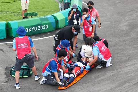 Tokyo 2020 Olympics - BMX Racing - Men's Individual - Semifinal - AUP - Ariake Urban Sports Park, Tokyo, Japan - July 30, 2021. Connor Fields of the United States receives medical attention. REUTERS/Matthew Childs