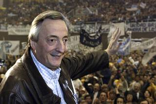 File photo of Argentina's President Nestor Kirchner waving to residents of his home province in Santa Cruz