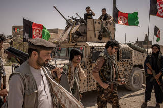 Militia and Afghan National Army soldiers near the front line with the Taliban, in the Balkh province of Afghanistan, July 10, 2021. (Jim Huylebroek/The New York Times)