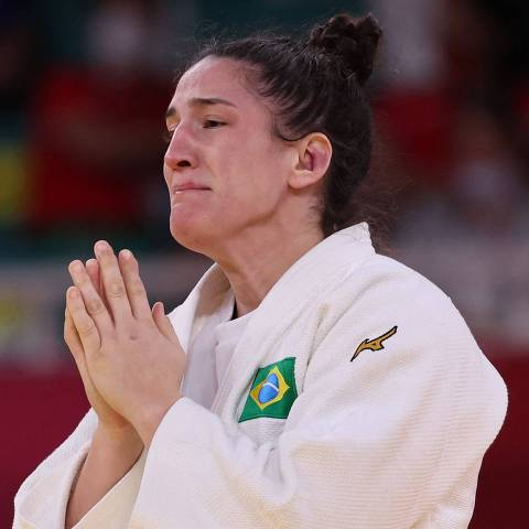 Brazil's Mayra Aguiar reacts after defeating South Korea's Hyunji Yoon in the judo women's -78kg bronze medal B bout during the Tokyo 2020 Olympic Games at the Nippon Budokan in Tokyo on July 29, 2021. (Photo by Jack GUEZ / AFP)