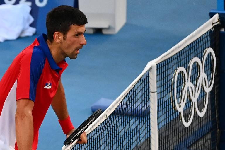 Número 1 do mundo e vencedor de três  Grand Slam no ano, o sérvio Novak Djokovic parece não acreditar após perder a medalha de bronze para o espanho Pablo Carreno Busta