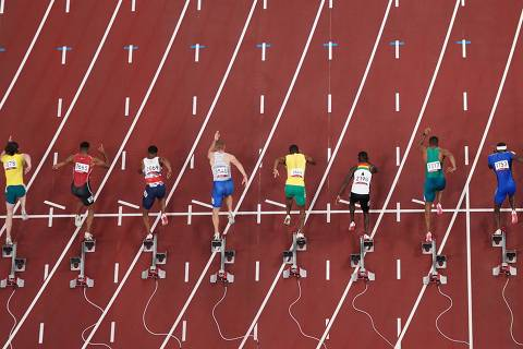 Tokyo 2020 Olympics - Athletics - Men's 100m - Round 1 - OLS - Olympic Stadium, Tokyo, Japan - July 31, 2021. Athletes in action during Heat 7 REUTERS/Fabrizio Bensch