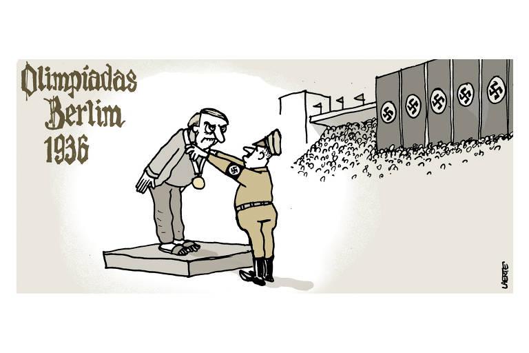 Charge leva o titulo Olimpiadas Berlim 1936. Nela, o presidente Jair Bolsonaro recebe uma medalha de um soldado do governo nazista; à direita, em uma espécie de arquibancada, há bandeiras com o simbolo do nazismo