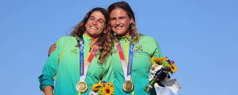 Tokyo 2020 Olympics - Sailing - Women's 49er FX - Medal Ceremony - Enoshima Yacht Harbour - Tokyo, Japan - August 3, 2021. Gold medallists Martine Grael of Brazil and Kahena Kunze of Brazil celebrate on the podium. REUTERS/Carlos Barria