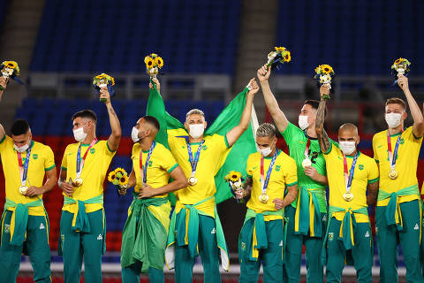 Tokyo 2020 Olympics - Soccer Football - Men's Team - Medal Ceremony - International Stadium Yokohama, Yokohama, Japan - August 7, 2021.  Gold medallists Brazil celebrate during the medal ceremony. REUTERS/Thomas Peter