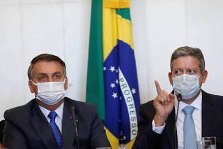 Brazil's President Jair Bolsonaro and Lower House Speaker Arthur Lira attend a meeting to deliver the interim measure for changes in social welfare program Bolsa Familia (Family Allowance)