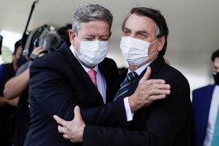 Brazil's President Jair Bolsonaro greets Brazil's Lower House Arthur Lira, after a meeting at the Planalto Palace, in Brasilia