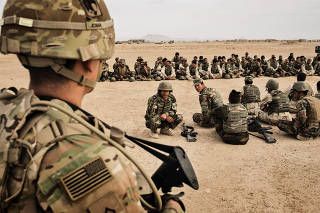 American soldiers overseeing training of their Afghan counterparts at Camp Bastion in Helmand Province,   Afghanistan, March 22, 2016. (Adam Ferguson/The New York Times)