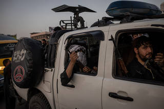 Taliban fighters drive into Kabul, Afghanistan, Aug. 15, 2021. (Jim Huylebroek/The New York Times)