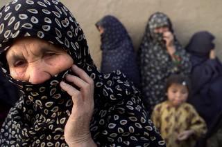 AFGHAN HAZARA REFUGEE WOMEN COVER THEIR FACES IN QUETTA