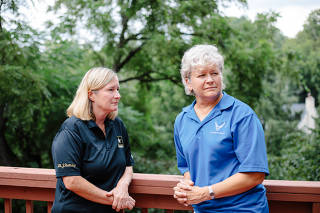 Ginger Wallace, right, a retired Air Force colonel, with her wife, Janet Holliday, a retired Army colonel, in Louisville, Ky., on Monday, August 16, 2021. (Andrew Cenci/The New York Times)