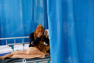 FILE PHOTO: A patient suffering from COVID-19 receives treatment at the Afghan-Japan Hospital in Kabul