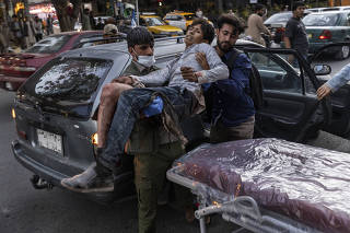 A person wounded in a bomb blast outside the Kabul airport in Afghanistan on Thursday, Aug. 26, 2021, arrives at a hospital in Kabul. (Victor J. Blue/The New York Times)