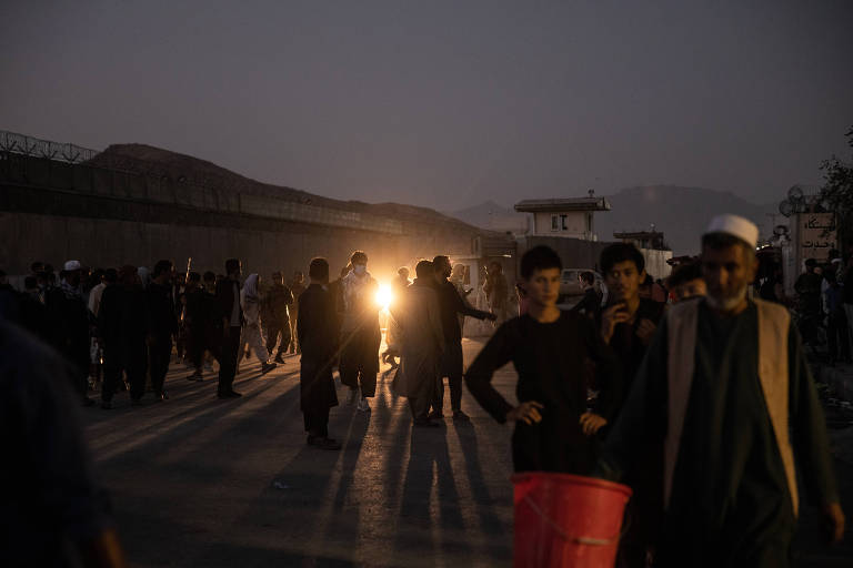 People are sent away from the scene of a bomb blast outside the Hamid Karzai International Airport in Kabul, Afghanistan on Thursday, Aug. 26, 2021. Pentagon officials said they were still piecing together the chain of events that took place at Abbey Gate on Thursday. (Jim Huylebroek/The New York Times)