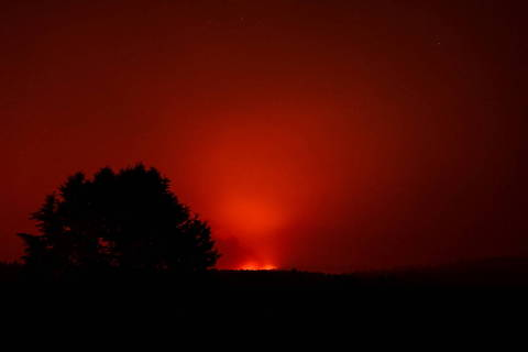 FILE PHOTO: The Bootleg Fire glows in the distance, near Beatty, Oregon, U.S., July 13, 2021. Picture taken July 13, 2021.   REUTERS/Mathieu Lewis-Rolland/File Photo ORG XMIT: FW1