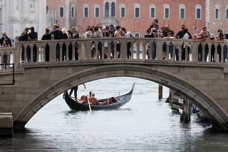 Tourists come back to Venice as Italy lifts COVID-19 quarantine for EU, UK and Israel