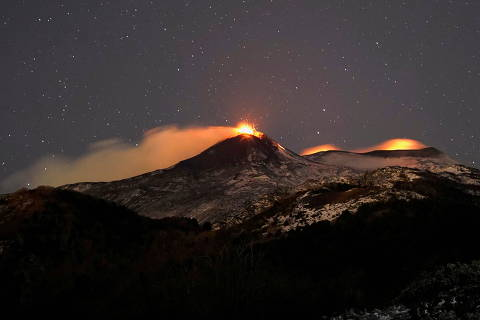 Large streams of red hot lava shoot into the night sky as Mount Etna, Europe's most active volcano, leaps into action, seen from the village of Fornazzo, in Catania, Italy, Feburary 15, 2021. REUTERS/Antonio Parrinello     TPX IMAGES OF THE DAY ORG XMIT: SIN