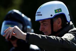 Brazil's President Bolsonaro leads a motorcade rally, in Brasilia
