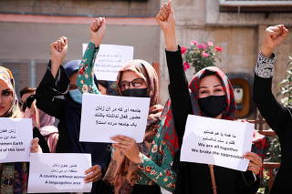 Afghan women's rights defenders and civil activists protest to call on the Taliban for the preservation of their achievements and education, in front of the presidential palace in Kabul