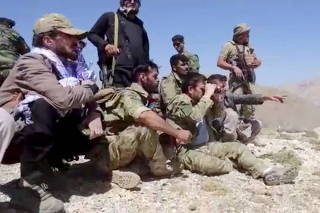 Members of National Resistance Front observe from a hill in Panjshir Valley