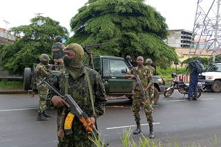 Army soldiers hold a checkpoint after the uprising that led to the toppling of President Alpha Conde in Kaloum neighbourhood of Conacry