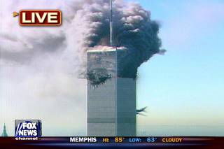 TV GRAB OF AIRLINER INSTANT BEFORE IT IMPACTS WORLD TRADE CENTER TOWER