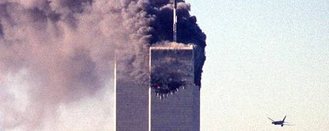 (FILES) In this file photo taken on September 11, 2001, a hijacked commercial aircraft approaches the twin towers of the World Trade Center shortly before crashing into the landmark skyscraper in New York. - The remains of two more victims of 9/11 have been identified, thanks to advanced DNA technology, New York officials announced on September 8, 2021, just days before the 20th anniversary of the attacks. The office of the city's chief medical examiner said it had formally identified the 1,646th and 1,647th victim of the al-Qaeda attacks on New York's Twin Towers which killed 2,753 people. They are the first identifications of victims from the collapse of the World Trade Center since October 2019. (Photo by SETH MCALLISTER / AFP) ORG XMIT: NYG02