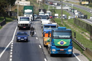 Truckers attend a protest on the BR-116 highway in Sao Paulo