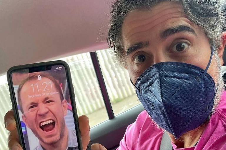 O apresentador Marcos Mion colocou uma foto do seu colega Tiago Leifert como fundo de tela do celular