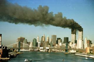 SMOKE RISES FROM WORLD TRADE CENTER AFTER TERRORIST ATTACK