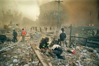 Firefighters amidst the ruins of the World Trade Center on Sept. 11