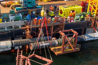 Specialists finish the construction of the Nord Stream 2 gas subsea pipeline in the Baltic Sea