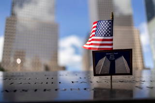 A postcard of the Twin Towers is seen at the 9/11 Memorial ahead of the 20th anniversary of the September 11 attacks in Manhattan, New York City, U.S.